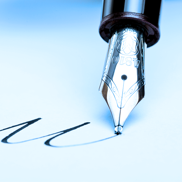 A fountain pen making signature